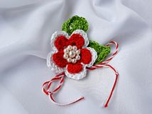Handmade crocheted flower with red and white string, known as Martisor. Handmade crocheted flower with red and white string, known as Martisor, it is a Romanian royalty free stock photography