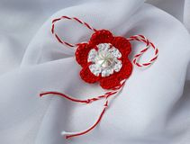 Handmade crocheted flower with red and white string, known as Martisor. Handmade crocheted flower with red and white string, known as Martisor, it is a Romanian stock photo