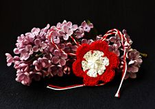 Handmade crocheted flower with red and white string, known as Martisor. Handmade crocheted flower with red and white string, known as Martisor, it is a Romanian stock image