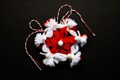 Handmade crocheted flower with red and white string, known as Martisor. Handmade crocheted flower with red and white string, known as Martisor, it is a Romanian stock photos