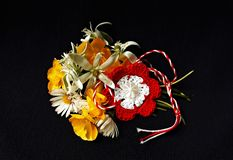 Handmade crocheted flower with red and white string, known as Martisor. Handmade crocheted flower with red and white string, known as Martisor, it is a Romanian stock photography