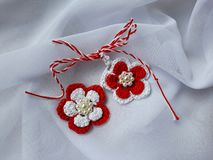 Handmade crocheted flowers with red and white string, known as Martisor. Handmade crocheted flowers with red and white string, known as Martisor, it is a royalty free stock photography