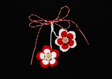 Handmade crocheted flowers with red and white string, known as Martisor. Handmade crocheted flowers with red and white string, known as Martisor, it is a stock photos