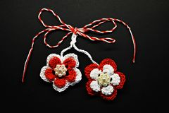 Handmade crocheted flowers with red and white string, known as Martisor. Handmade crocheted flowers with red and white string, known as Martisor, it is a stock image
