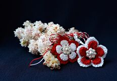 Handmade crocheted flowers with red and white string, known as Martisor. Handmade crocheted flowers with red and white string, known as Martisor, it is a royalty free stock photo
