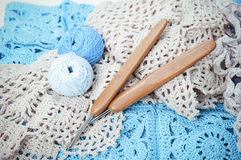 Handmade crocheted lace napkin with hooks Stock Photography