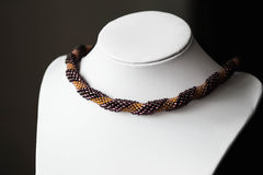 Handmade crocheted necklace made of beads of two colors Royalty Free Stock Images