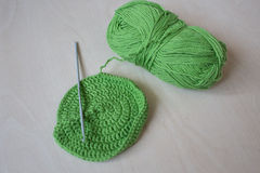 Handmade crocheted pot with green wool Royalty Free Stock Photos