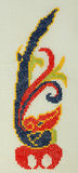 Handmade cross-stitch Chinese symbol of longevity in the form o Stock Images
