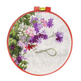 Handmade cross-stitch with floral pattern on canvas. Isolated on white background stock photo