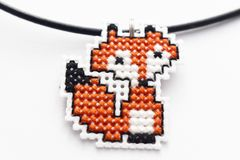 Handmade Cross Stitch Necklace Fox. Embroidered on white plastic canvas stock image