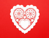 Handmade Cutout Fancy Paper Heart. Isolated on red background Royalty Free Stock Images