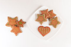 Handmade decorated ginger cookies. On the white background Royalty Free Stock Photography
