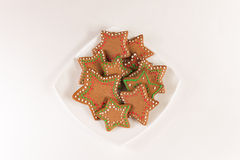 Handmade decorated ginger cookies. On the white background Stock Photos
