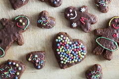 Handmade decorated gingerbread heart and people Stock Images