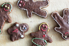 Handmade decorated gingerbread people Stock Photography