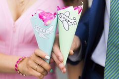 Handmade decorative colorful paper cones of rose petals with funny planes. Handmade decorative colorful paper cones of rose petals for wedding ceremony with stock photo