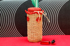 Handmade decorative vase, bottle, jar made of wool Stock Photo
