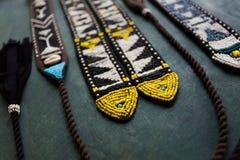 Handmade design boho belt accessories on black wooden background. Handmade design boho belt accessories royalty free stock photos