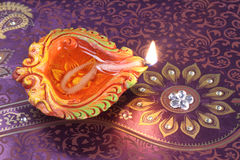 Handmade Diwali Clay Lamp on Floral Background Royalty Free Stock Image