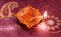 Handmade Diwali Clay Lamp on Floral Background Stock Photo