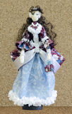 Handmade doll in a ball gown Royalty Free Stock Image
