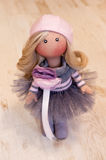 Handmade doll with natural hair in a pink beret Stock Images