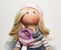 Handmade doll with natural hair in a pink beret Royalty Free Stock Photos