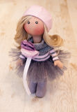 Handmade doll with natural hair in a pink beret Stock Photos
