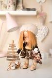 Handmade doll. Pretty handmade chic interior dolls Royalty Free Stock Images