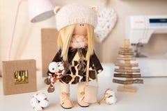 Handmade doll. Pretty handmade chic interior dolls Stock Photography