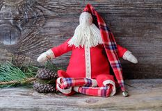Handmade doll Santa Claus sitting in the Lotus position stock images