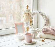 Free Handmade Doll With Tea Set And Marshmallows Near Window. Cozy Winter Morning Breakfast. Christmas Concept And Mood. Postcard Royalty Free Stock Image - 166231826