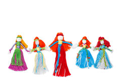 Handmade dolls holding hands on white Royalty Free Stock Photography