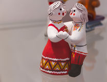 Handmade dolls love. Handmade dolls (couple - man and woman) of clay symbolizing the love dressed in traditional national russian clothes and dancing at the flea Royalty Free Stock Photography