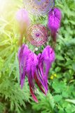 Handmade dream catcher with feathers threads and beads rope hanging. Dream catcher with feathers threads and beads rope hanging. Dreamcatcher handmade Royalty Free Stock Photo