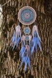 Handmade dream catcher with feathers threads and beads rope hanging. Dream catcher with feathers threads and beads rope hanging. Dreamcatcher handmade dream stock photos