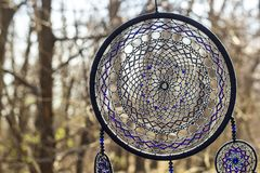 Handmade dream catcher with feathers threads and beads rope hanging. Dream catcher with feathers threads and beads rope hanging. Dreamcatcher handmade dream stock photo