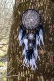 Handmade dream catcher with feathers threads and beads rope hanging. Dream catcher with feathers threads and beads rope hanging. Dreamcatcher handmade dream stock photography