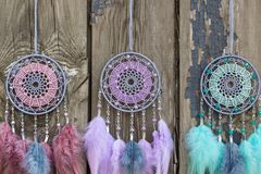 Handmade dream catcher with feathers threads and beads rope hanging. Dream catcher with feathers threads and beads rope hanging. Dreamcatcher handmade, dream royalty free stock images