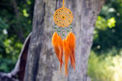 Handmade dream catcher with feathers threads and beads rope hanging. Dream catcher with feathers threads and beads rope hanging. Dreamcatcher handmade, dream stock photography