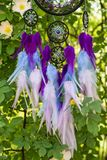 Handmade dream catcher with feathers threads and beads rope hanging. Dream catcher with feathers threads and beads rope hanging. Dreamcatcher handmade, dream royalty free stock image