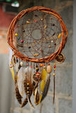 Handmade dream catcher at wall in background Stock Photos