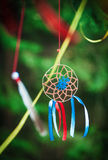 Handmade dreamcatcher in the forest. Beautiful handmade dreamcatcher in the forest outdoor Royalty Free Stock Images