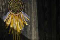 Handmade dreamcatcher on wooden background stock images