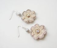 Handmade ear-rings. A beautiful small white handmade earrings Stock Photography