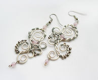 Handmade ear-rings. A pair of two handmade ear-rings with stone and metal round beads Stock Photography