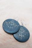 Handmade earings. Handmade wood earings on a board Royalty Free Stock Images