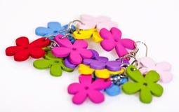 Handmade earrings. Some wooden handmade colored flowers earring Royalty Free Stock Photo