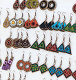 Handmade earrings. Display of colorful handmade souvenir earrings Stock Photo
